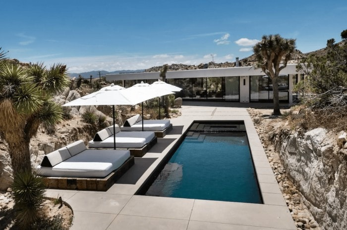 Stunning pool deck at the glass modern house in Joshua Tree
