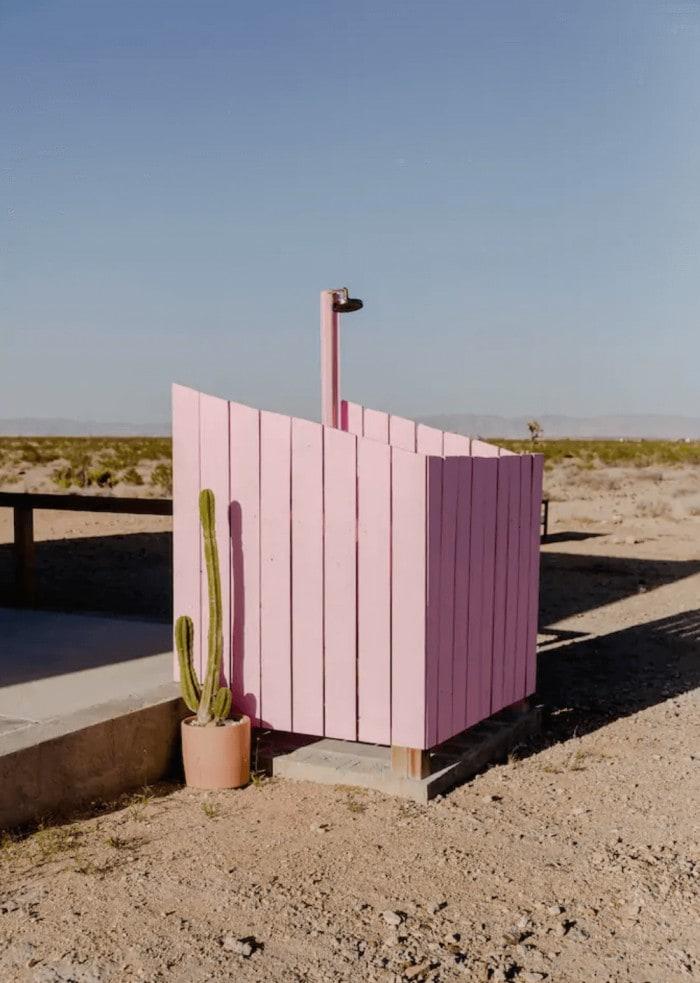 Pink outdoor shower at El Rancho Joshua Tree