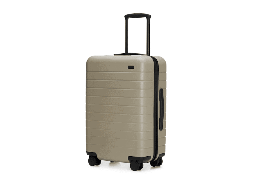 Away's functional hard case luggage includes built in battery charger and TSA-approved lock