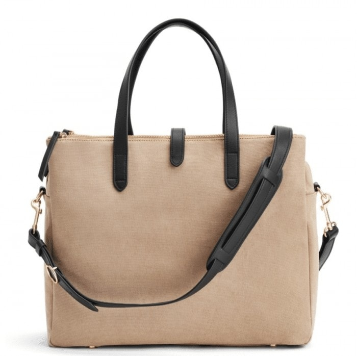 stylish travel gifts for women - Cuyana overnight bag in two-tone beige and black