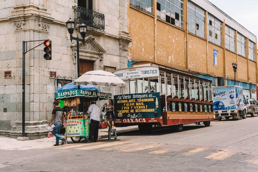 Trolleys and street vendors in Oaxaca city, Mexico