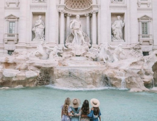 Girls trip in Rome, Italy standing in front of the Trevi Fountain