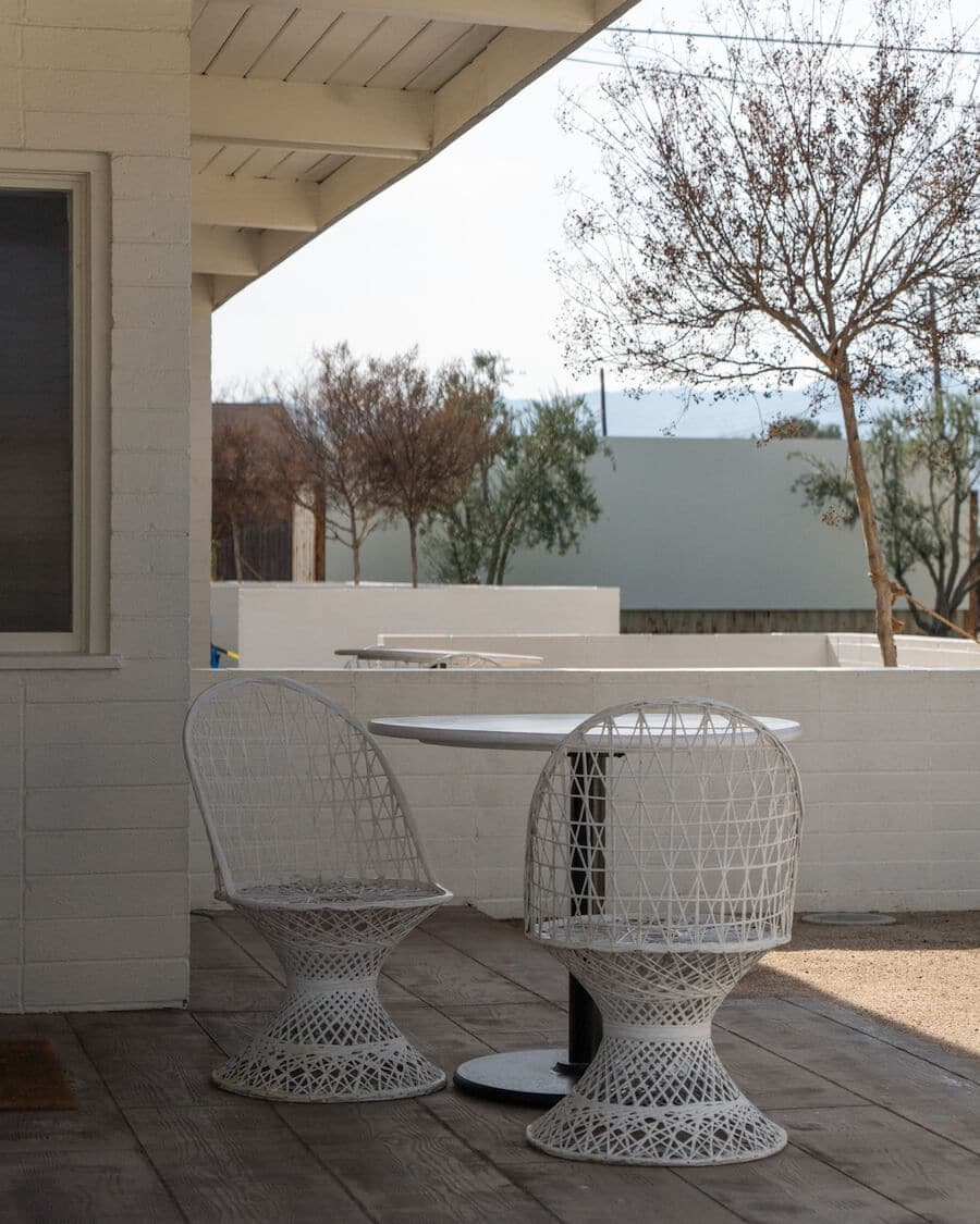 Mid century modern white chairs on room terrace at the Cuyama Buckhorn