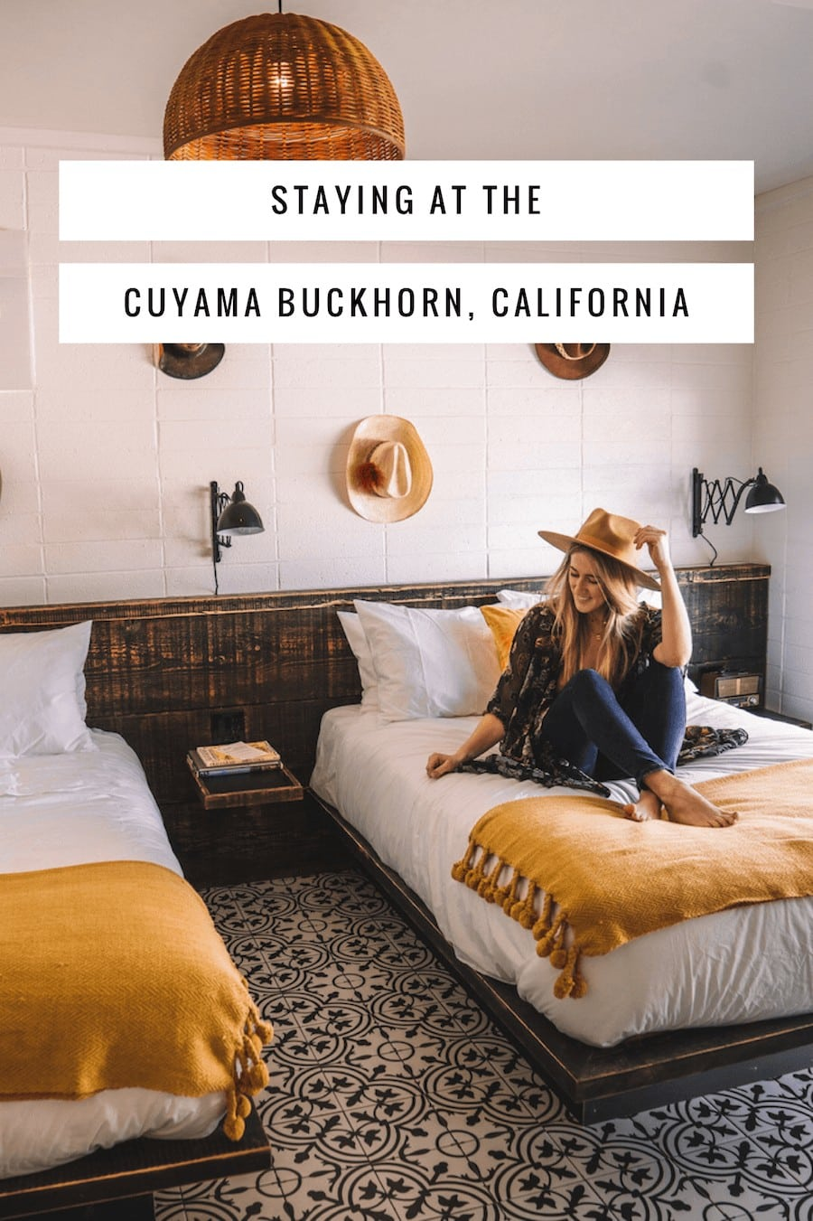 Girl sitting on bed in hotel room at the Cuyama Buckhorn