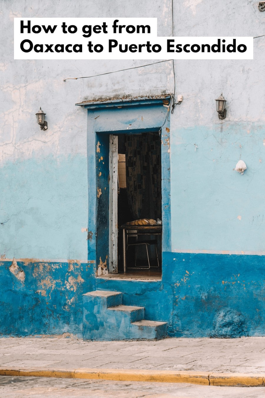 Doorway in Oaxaca with shades of crackled blue paint and text overlay