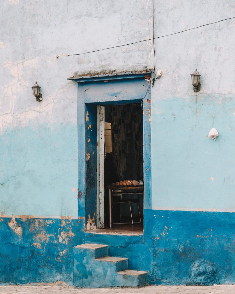 Doorway in Oaxaca with shades of crackled blue paint