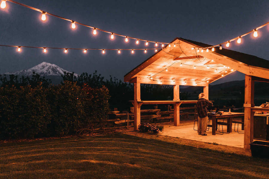 Glamping site at night with string lights