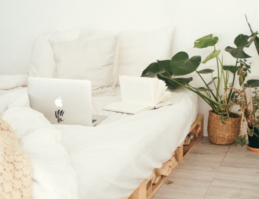 Laptop sitting in unmade bed