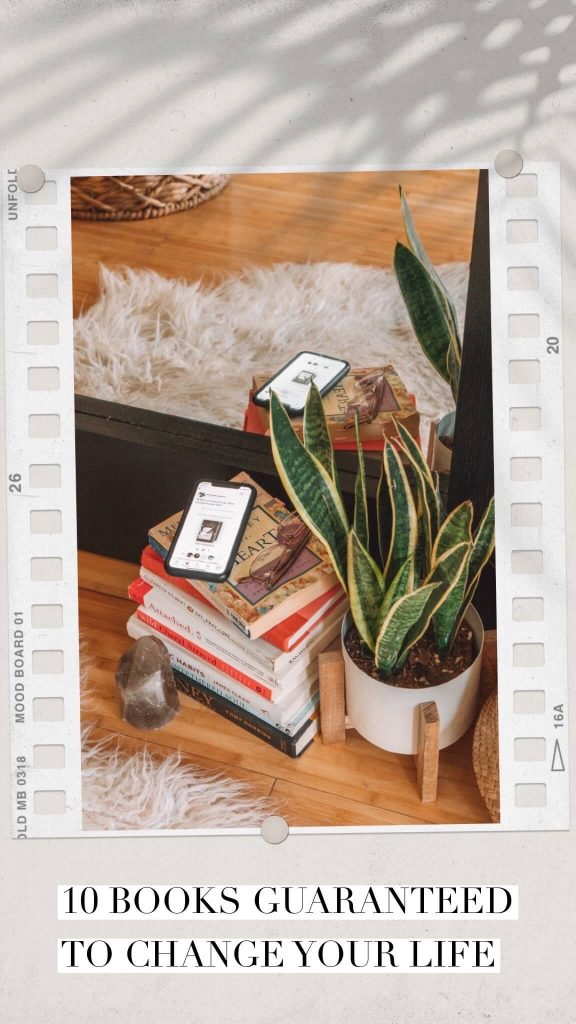 Stack of books next to a plant