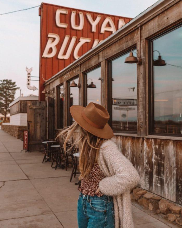 In front of the Cuyama Buckhorn roadside motel in Cuyama, California