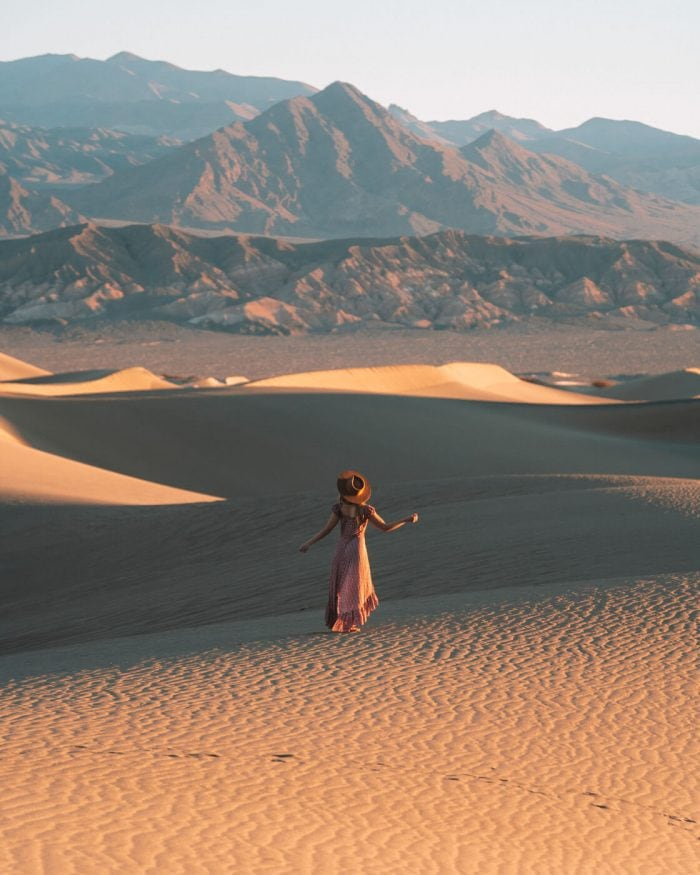 Girl standing in a dress on the Mesquite Flat Sand Dunes