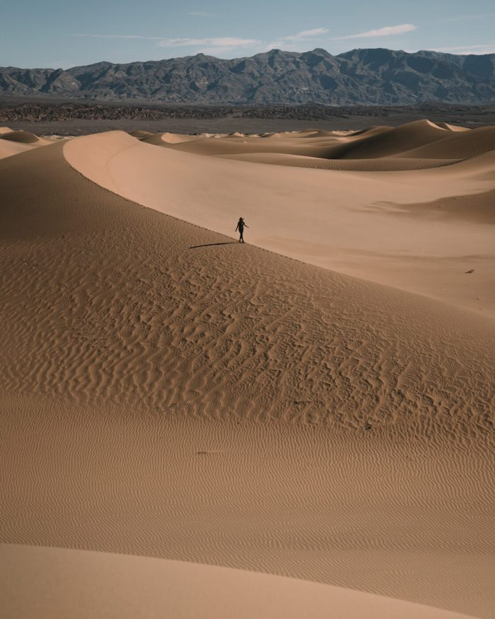 Small person walking the sand dunes in Death Valley