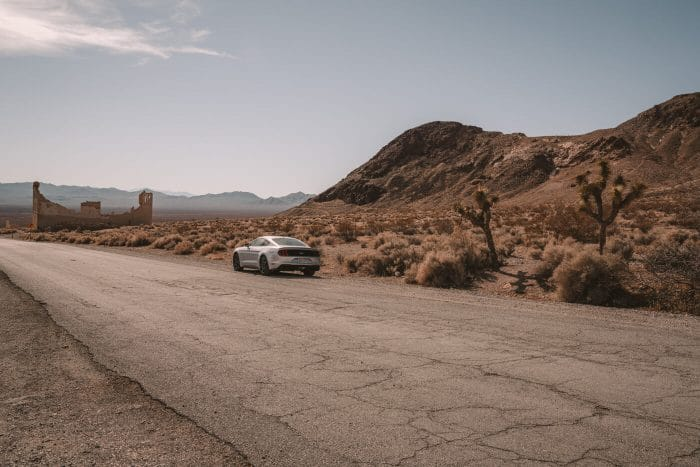 Silver mustang parked beside the road in Death Valley ghost town