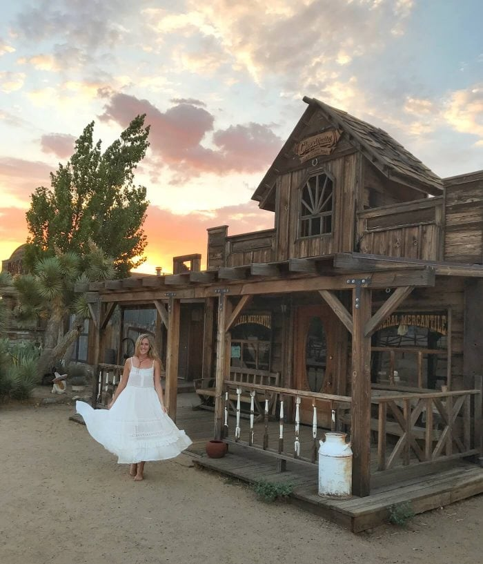 Girl in white dress in Pioneertown, California