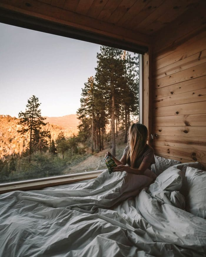 Sitting in bed in the Getaway Cabins