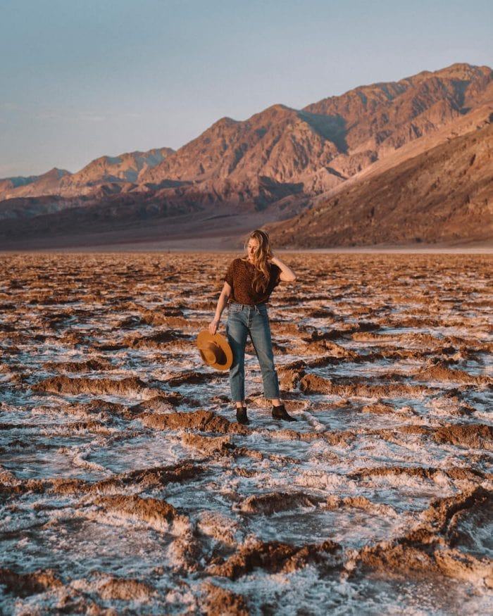 Girl standing in salt flats at Badwater Basin
