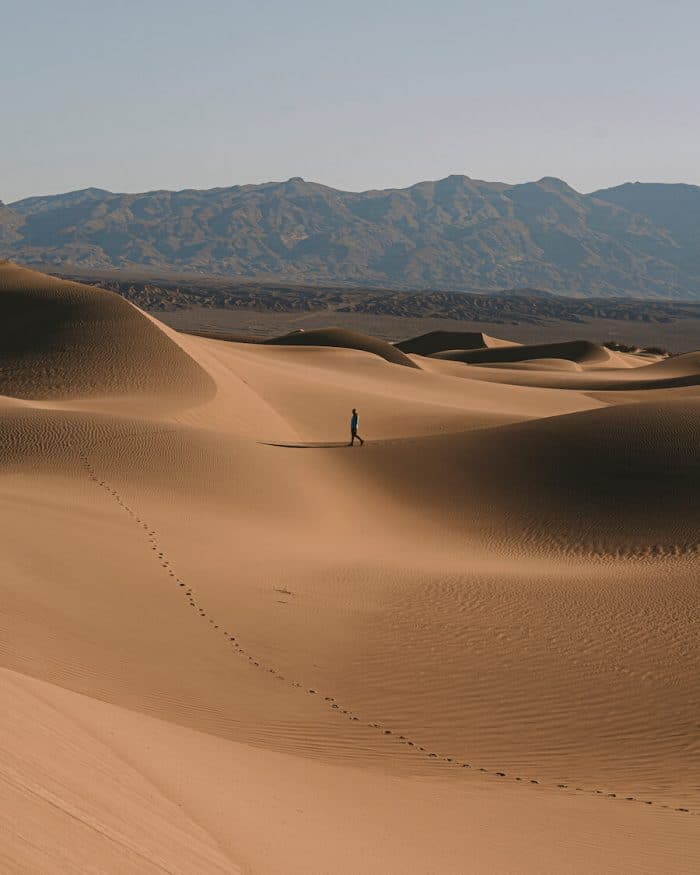 Small human walking along Mesquite Flat Sand Dunes