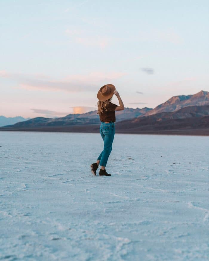 Girl standing on the surface of Badwater Basin
