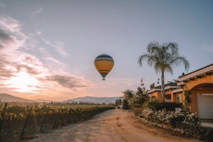 Hot air balloon hovering over Carter Estate winery, at one of the best wine regions in California