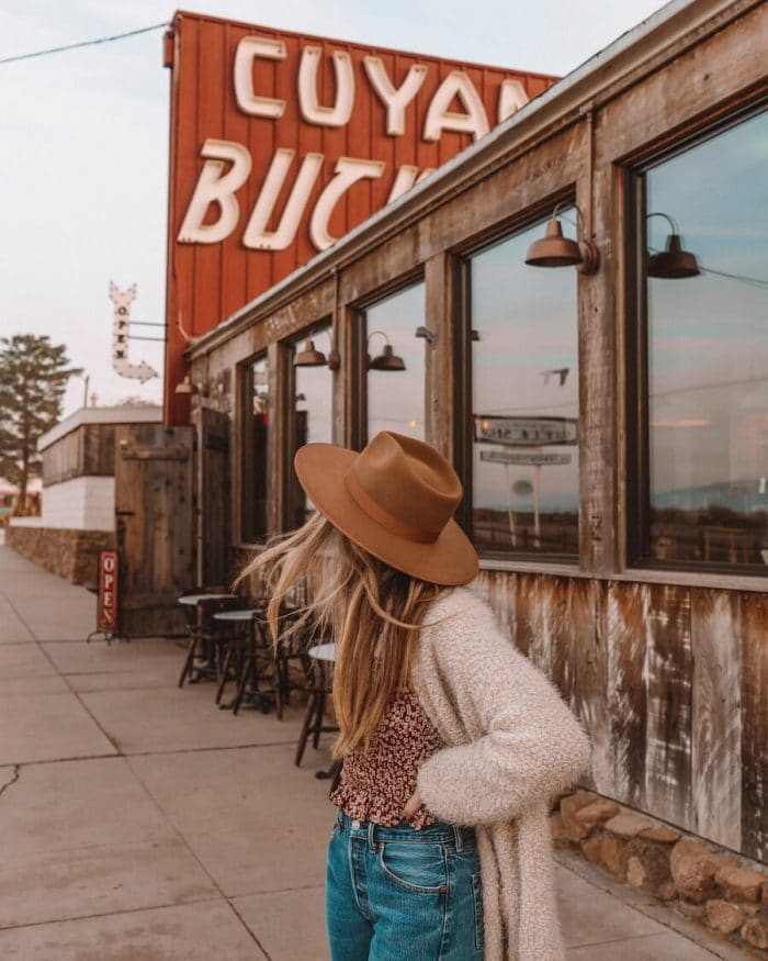 Girl with hat in front of Cuyama Buckhorn boutique hotel