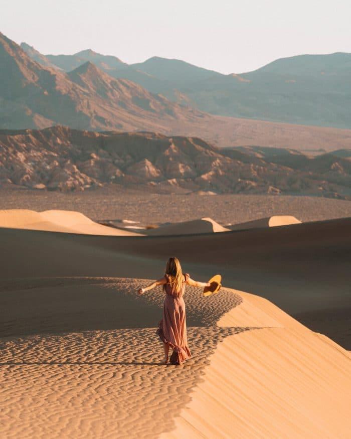 Girl in dress at mesquite flat sand dunes