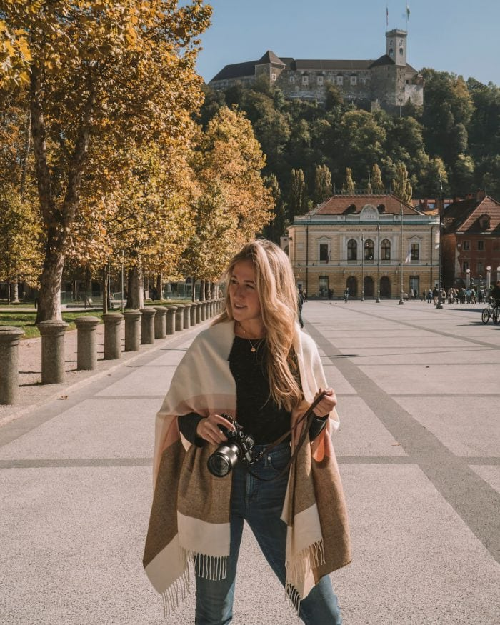 girl with camera in Ljubljana, Slovenia - best budget travel insurance
