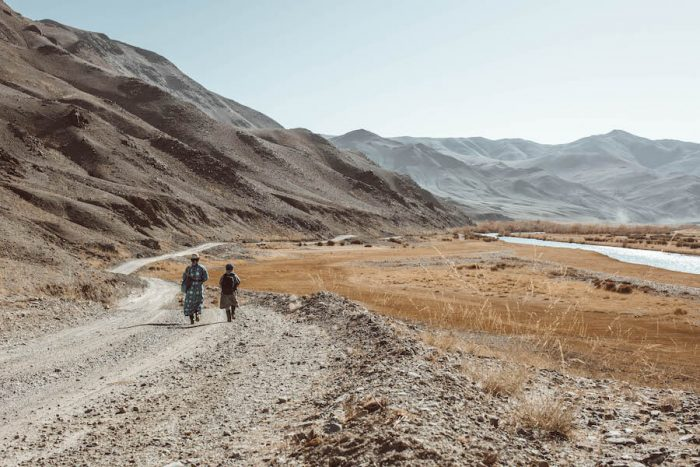 People walking through Altai Mountains in Western Mongolia itinerary