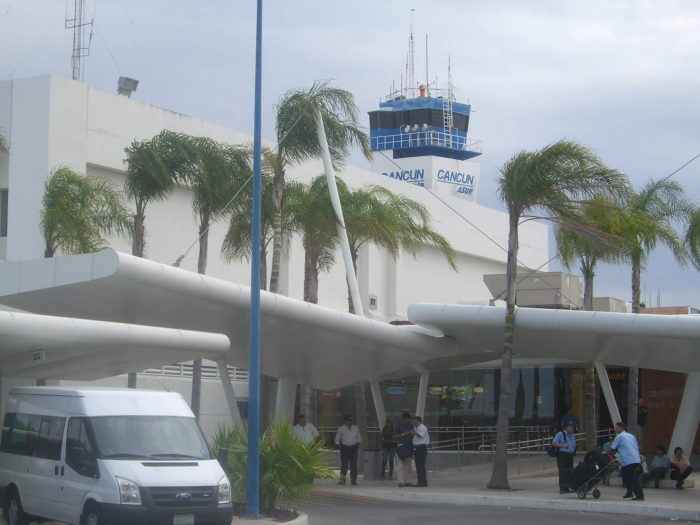 Outside Cancun Airport and shuttle bus