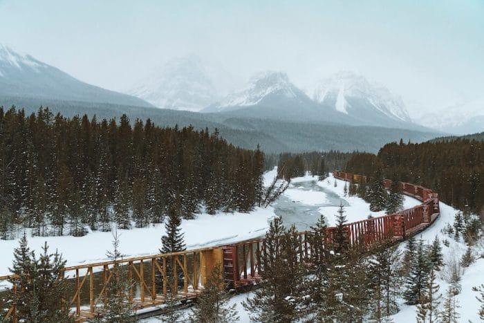 Train running through snowy Banff