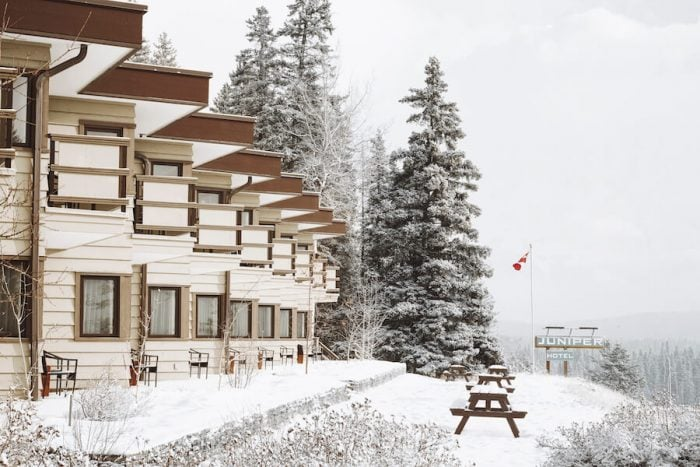 Exterior of the Juniper Hotel in the winter - where to stay in Banff
