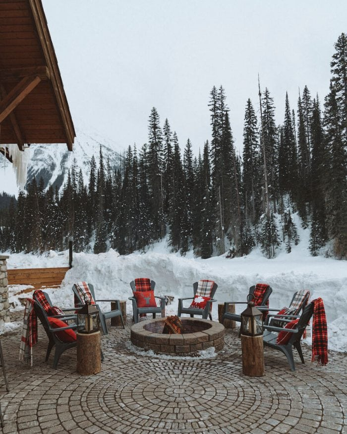 Cozy chairs around the fireplace at Emerald Lake Lodge - where to stay in Banff