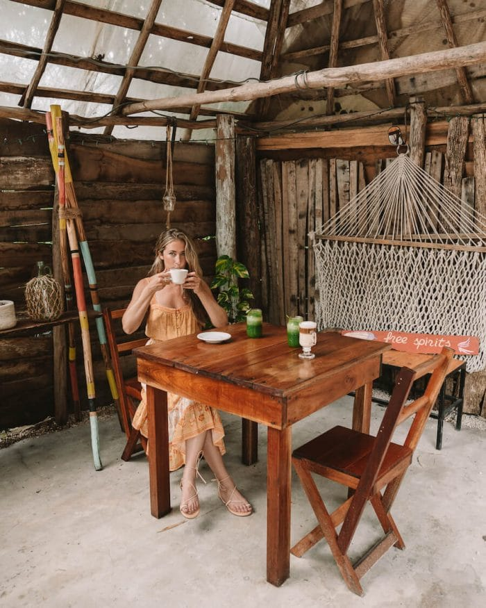 Michelle Halpern drinking coffee at a cafe in Bacalar, Mexico