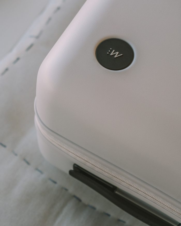 Close up of Monos luggage logo