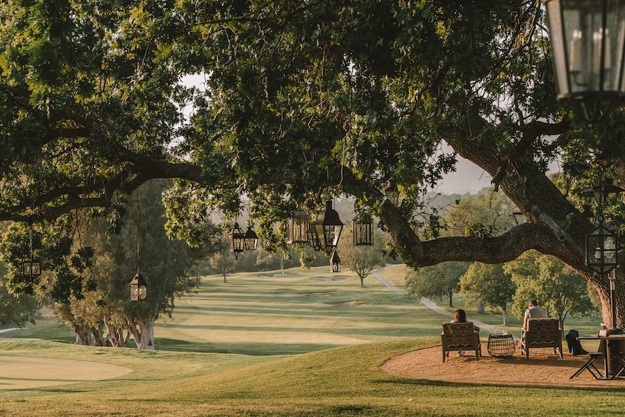 Golf course and lantern filled trees at the Ojai Valley Inn