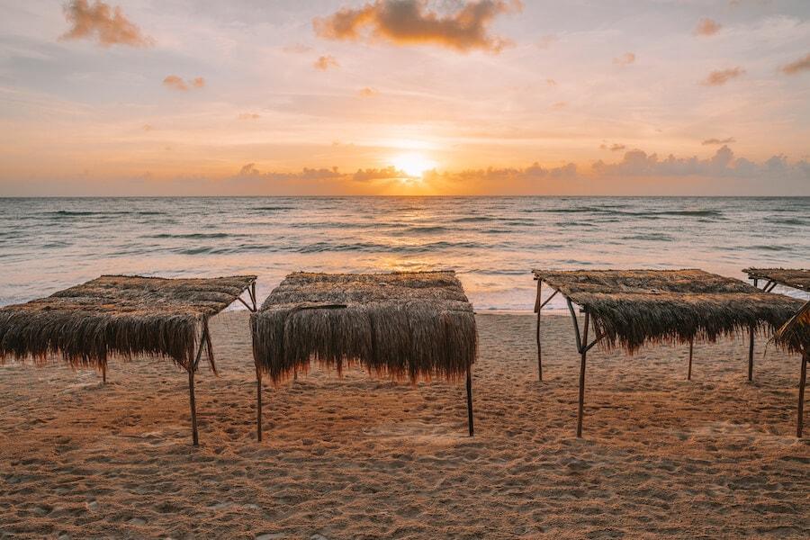 Sunrise over the beach huts at Papaya Playa Project