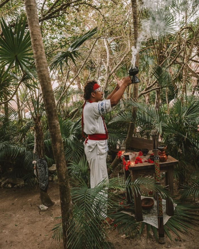 Shaman performing cacao ceremony (best things to do in Tulum)
