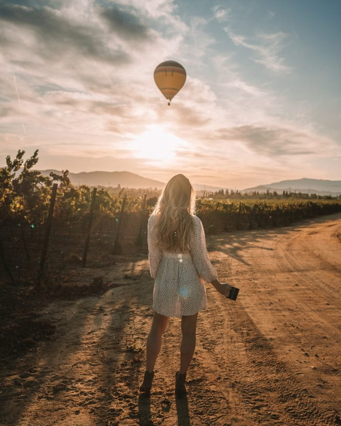 Michelle Halpern standing in Temecula looking at hot air balloon