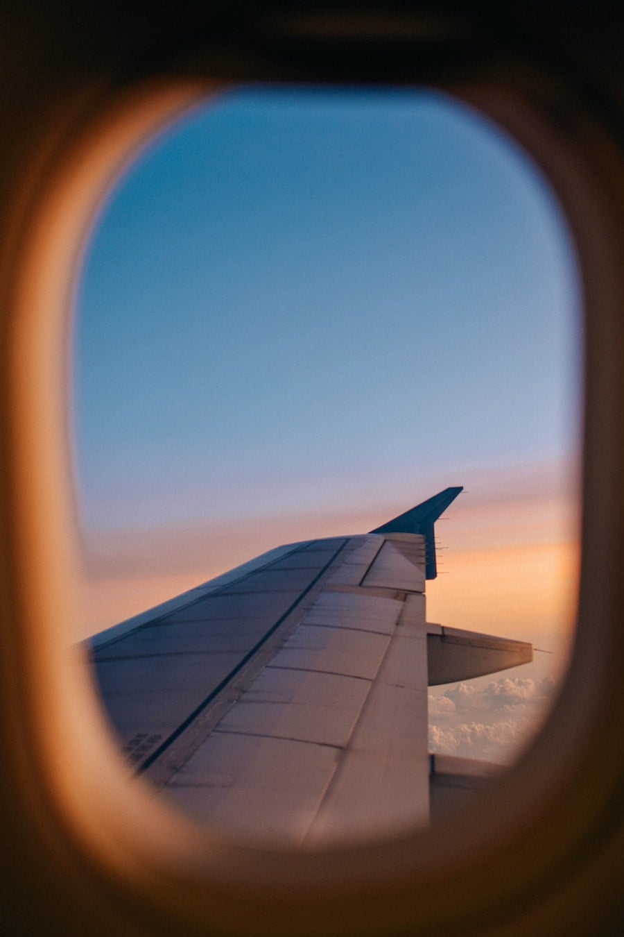 sunset out airplane window - tips for overnight flights