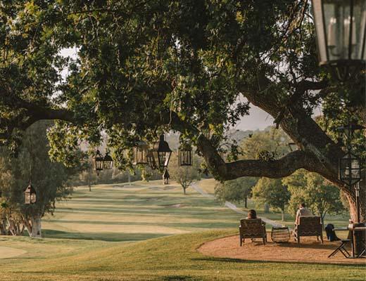 Seats overlooking golf course at Ojai Valley Inn