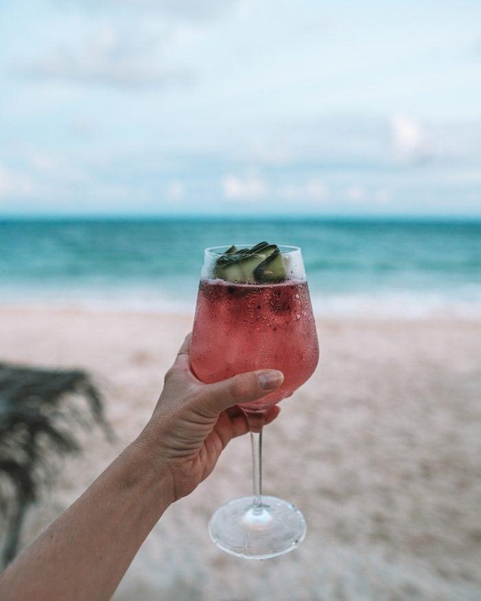 Papaya Playa Project review - having cocktails beachside