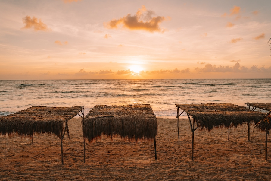 Beach huts at Papaya Playa Project at sunrise