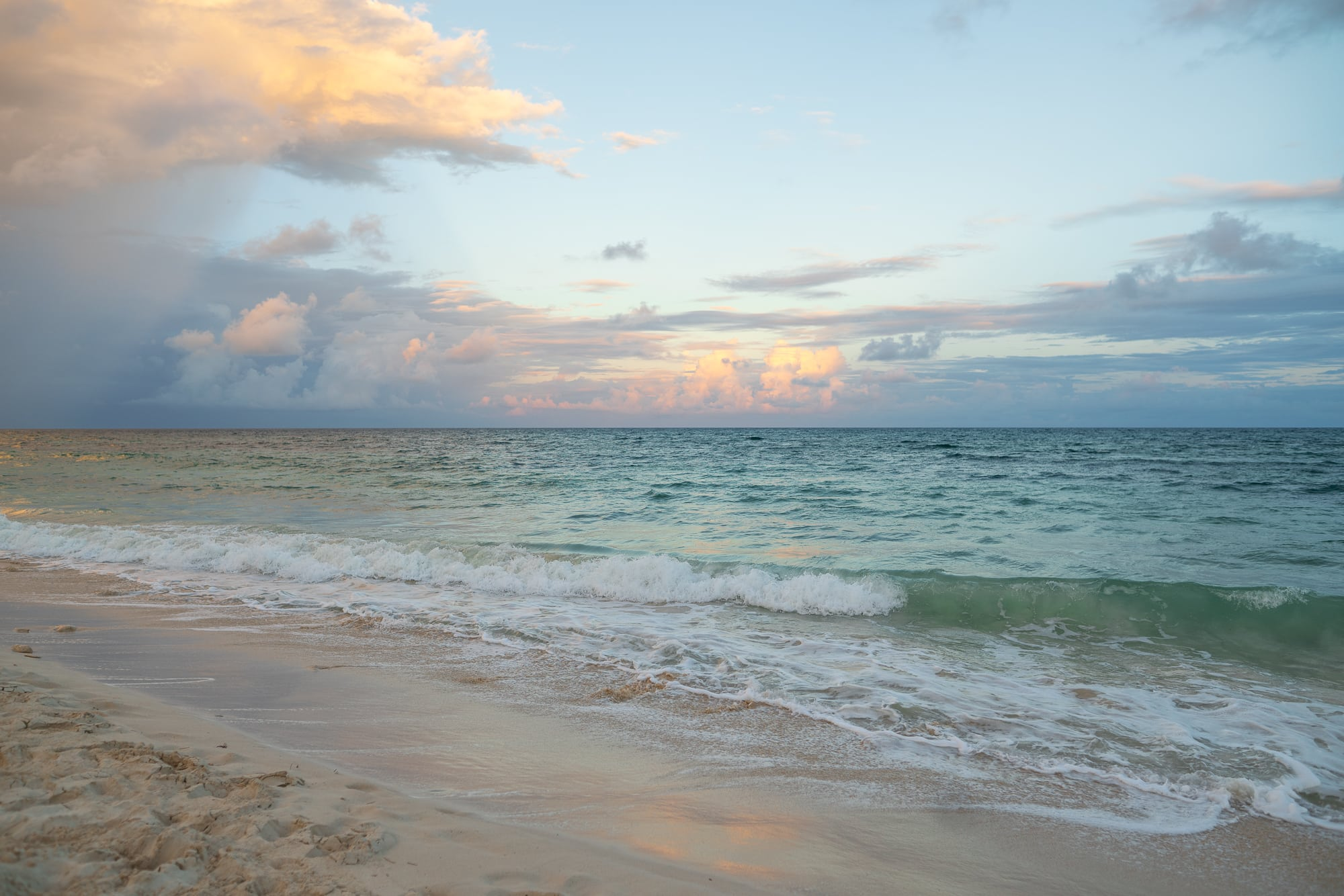 Tulum's turquoise waters at sunset