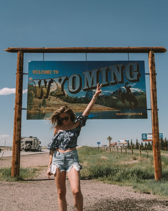 Michelle Halpern in front of the Wyoming sign