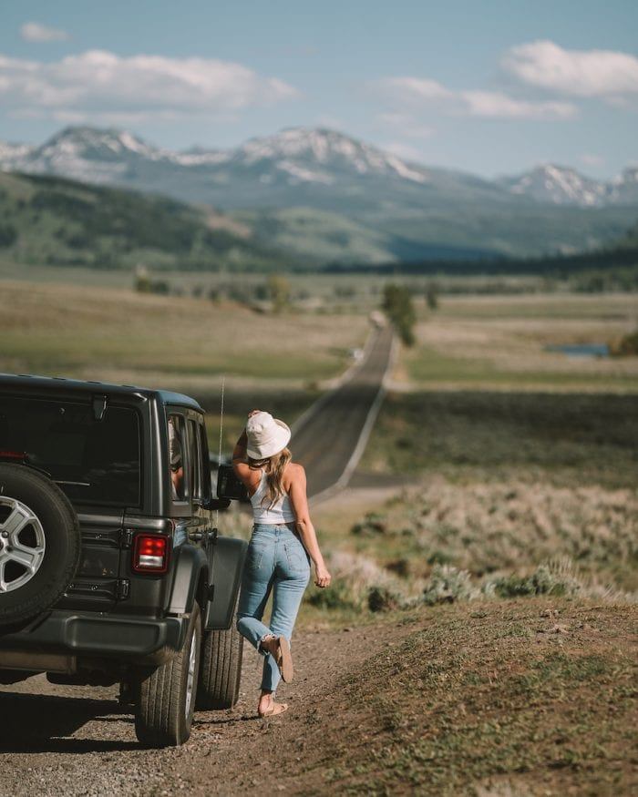 Michelle Halpern leaning against a Jeep wrangler in Lamar Valley
