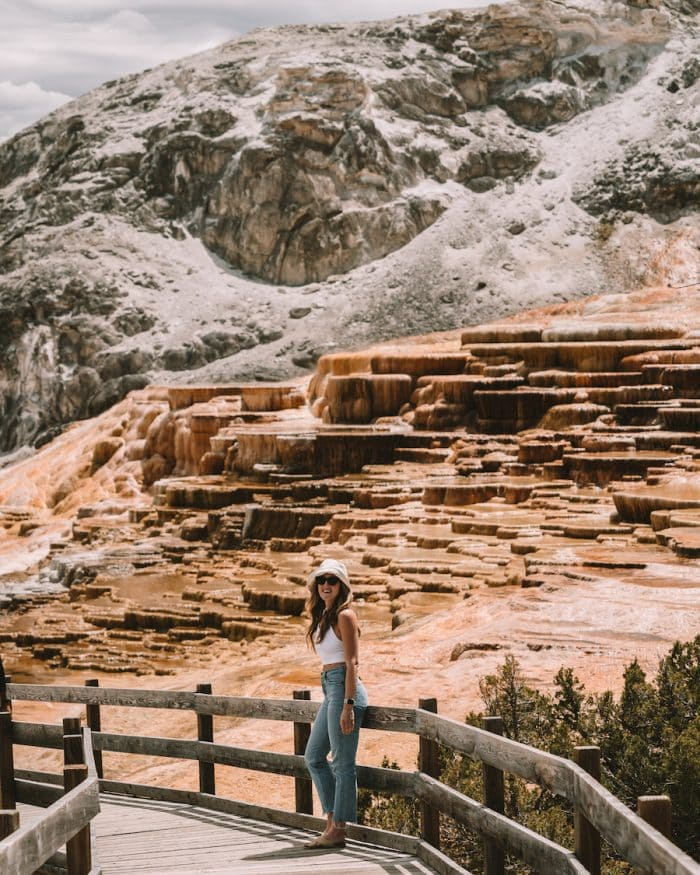 Michelle Halpern standing in front of Mammoth Hot Springs