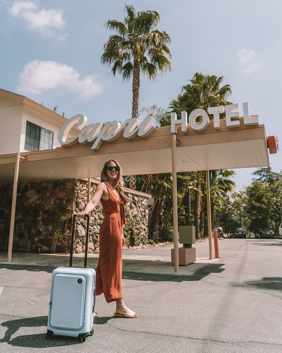 Michelle Halpern with the Monos Carry on luggage with laptop compartment