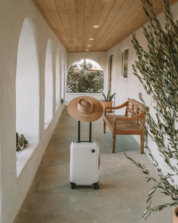 Carry on luggage with laptop compartment by Monos