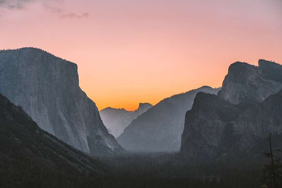 Sunrise light coming up over Tunnel View in Yosemite