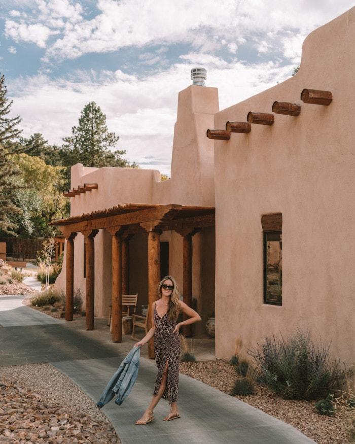 Michelle Halpern standing in front of adobe architecture at Bishop's Lodge