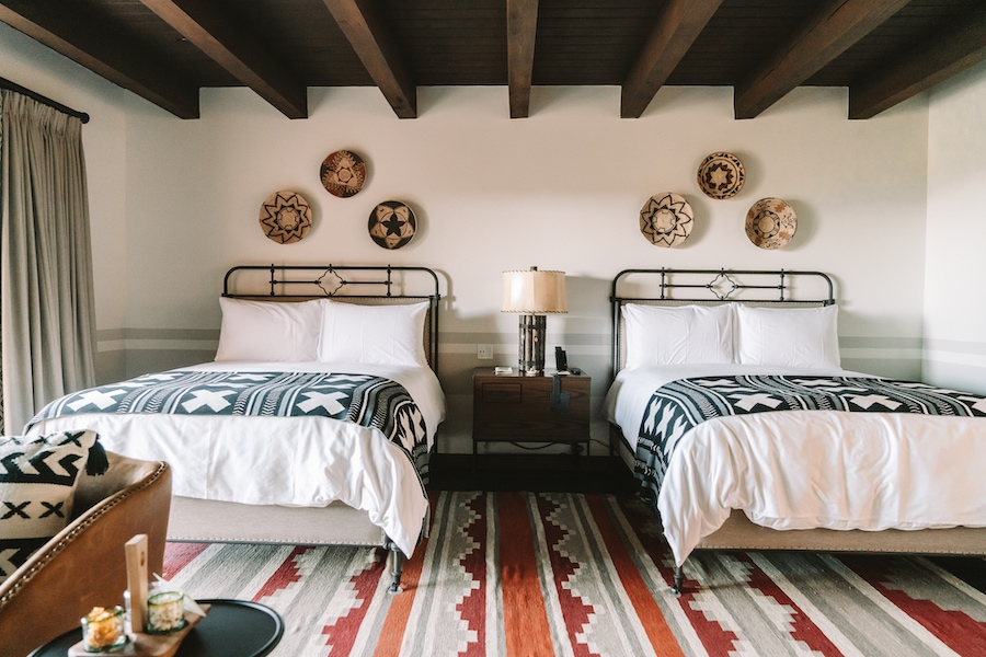 Double bed room with authentic textiles at Bishop's Lodge